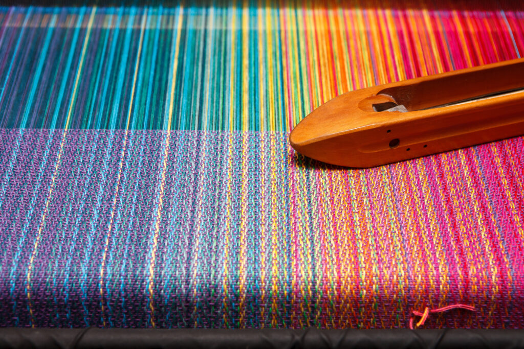 colorful woven fabric on loom